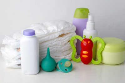 Set of accessories for the baby - diapers, cream, powder. rattle, pacifier, syringe