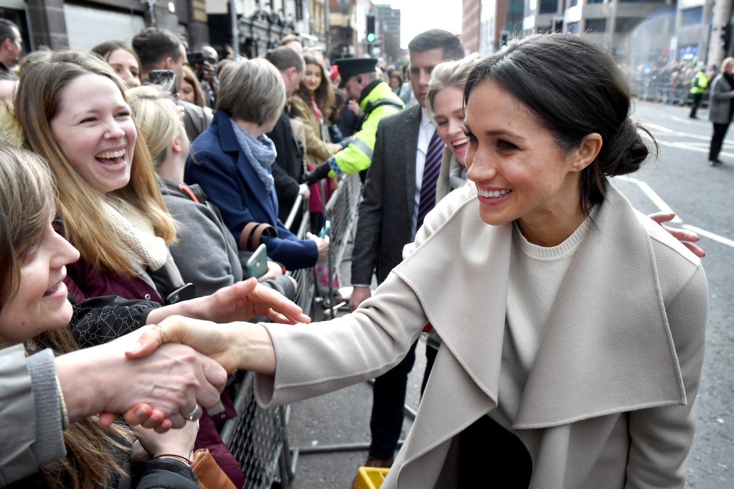 meghan markle shaking hands photo