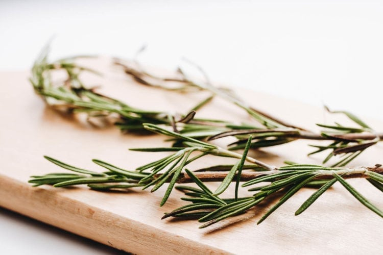 Fresh rosemary on a wooden board. Close up